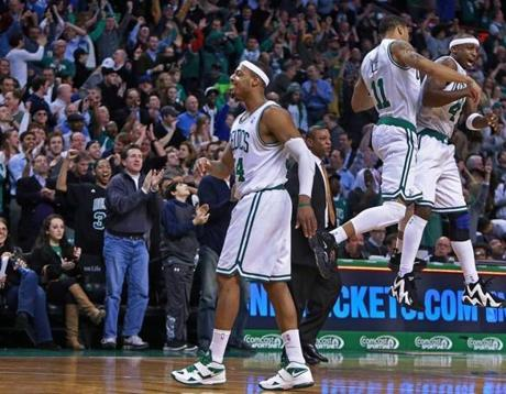 After a frantic final few seconds (from left) Paul Pierce, coach Doc Rivers, Courtney Lee (11), and Jason Terry celebrate the Celtics' win.